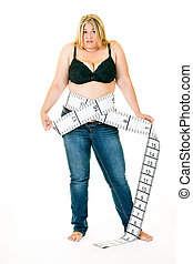 Overweight woman with tape measure around waist - Overweight...