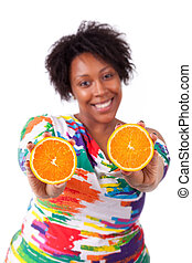 Overweight young black woman holding  orange slices, isolated on white background - African people