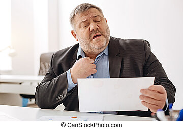 Overwhelmed hard-working man feeling stressed
