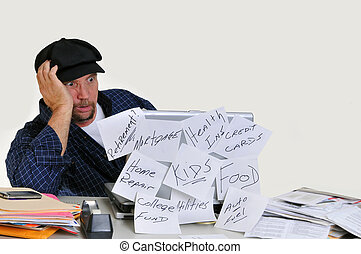 Overwhelmed man with finances - Overwhelmed man looking at ...