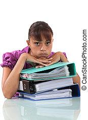 overwhelmed secretary sitting on her desk