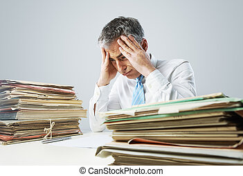 Overwork - Stressed businessman, with a too much paperwork...