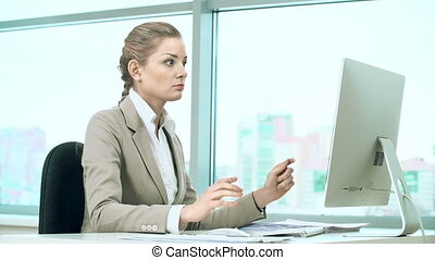 Overwork Stress - Woman at office computer suffering from...