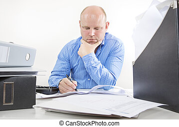 Overworked businessman at the office - Busy office worker or...