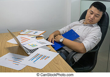 Overworked businessman in formal wear tired and sleeping in...