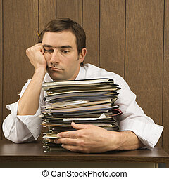 Overworked businessman. - Mid-adult Caucasian male with...