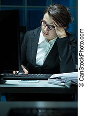 Overworked businesswoman having problem
