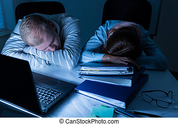 Overworked people sleeping at the work