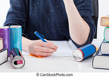 Overworked student with energy drinks - Overworked student...