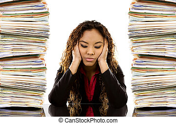 Overworked Woman - Stock image of woman sitting at desk with...