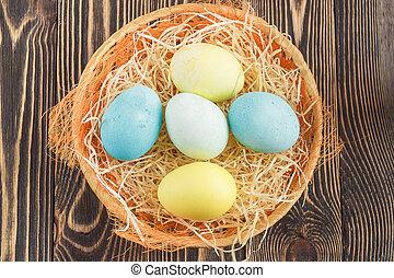 ovos páscoa, em, ninho, ligado, madeira, fundo