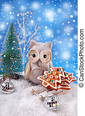 owl with christmas gingerbread cookies on sledge
