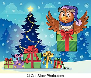 Owl with gift near Christmas tree