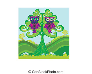 Owls couple sitting on a green tree