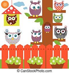 Owls sitting on a tree.