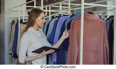 Owner of women's clothing shop is checking and counting...
