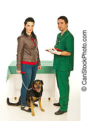 Owner with dog in veterinary office
