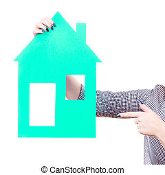 Woman hand holding blue paper house