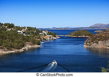 Oygarden, Norway - Misje and Sotra islands landscape. Summer in Norway. Fishing boat.