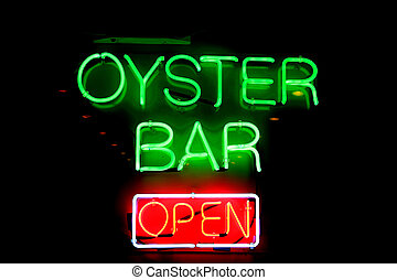 Oyster Bar - A big neon sign advertising an oyster bar.