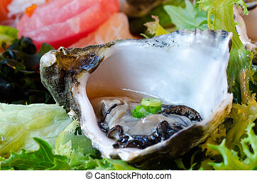 Oyster Sashimi - A dish of assorted sashimi with the oyster ...