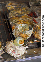 Image of some traditional oyster shells on the grill. This is a specific food during spring and autumn in some areas from Japan(Matsushima is one of them).