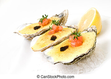 oysters with sauce and lemon on pla