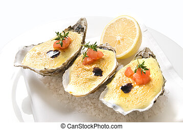 oysters with sauce and lemon on plate