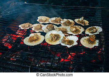oysters with sauce are fried on fire