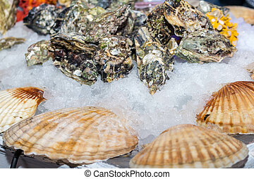 Oysters with seasoning on the table with ice