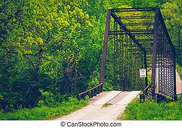 Ozarks Wooden Bridge - A wooden plank bridge on a gravel ...