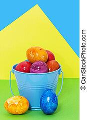 påsk eggar, in, a, hink, på, a, färgad fond
