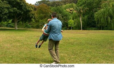 père fils, jouer, dans, a, parc
