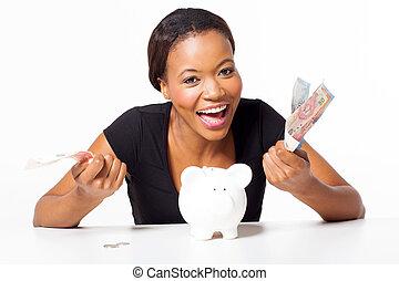 pénz, nő, afrikai