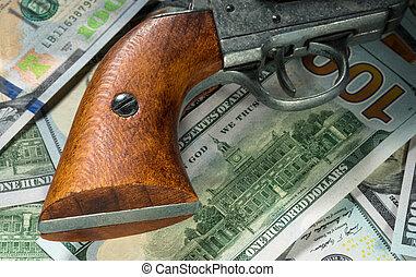 pénz, pisztoly