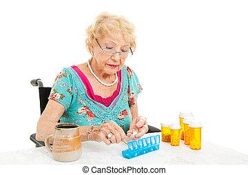 píldoras, sílla de ruedas, mujer, condes