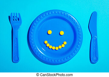 pílulas felizes, ligado, criança, prato