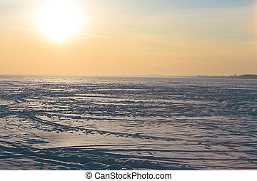 pôr do sol, sobre, a, congelado, inverno, lago
