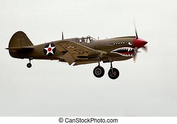P-40 Landing - A World War II Curtiss P-40 airplane landing...