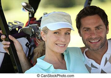 paar, golfen, sportkleidung