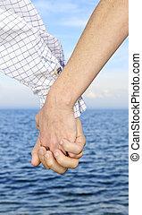 paar handen vast te houden