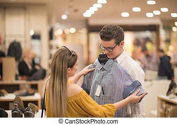 Paar, kleidung, kaufmannsladen