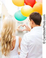 paar, mit, farbenprächtige luftballons