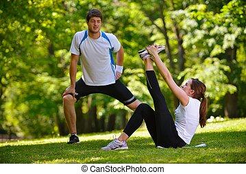 paar, nach, jogging, übung, dehnen