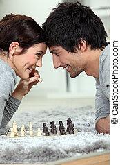 paar, spelend schaakspel