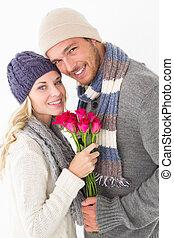 paar, warm, attraktive, halten blüten, kleidung