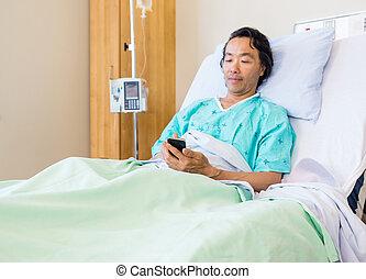 paciente, móvil, cama del hospital, teléfono, utilizar