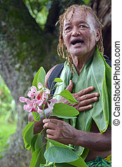 Pacific Islander man explains about exotic flower on eco ...