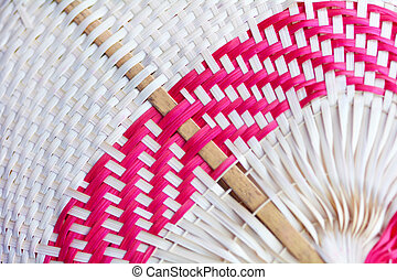 Pacific Islands woven fan close up background in Rarotonga, ...