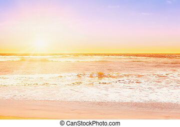 Pacific ocean waves at sunset